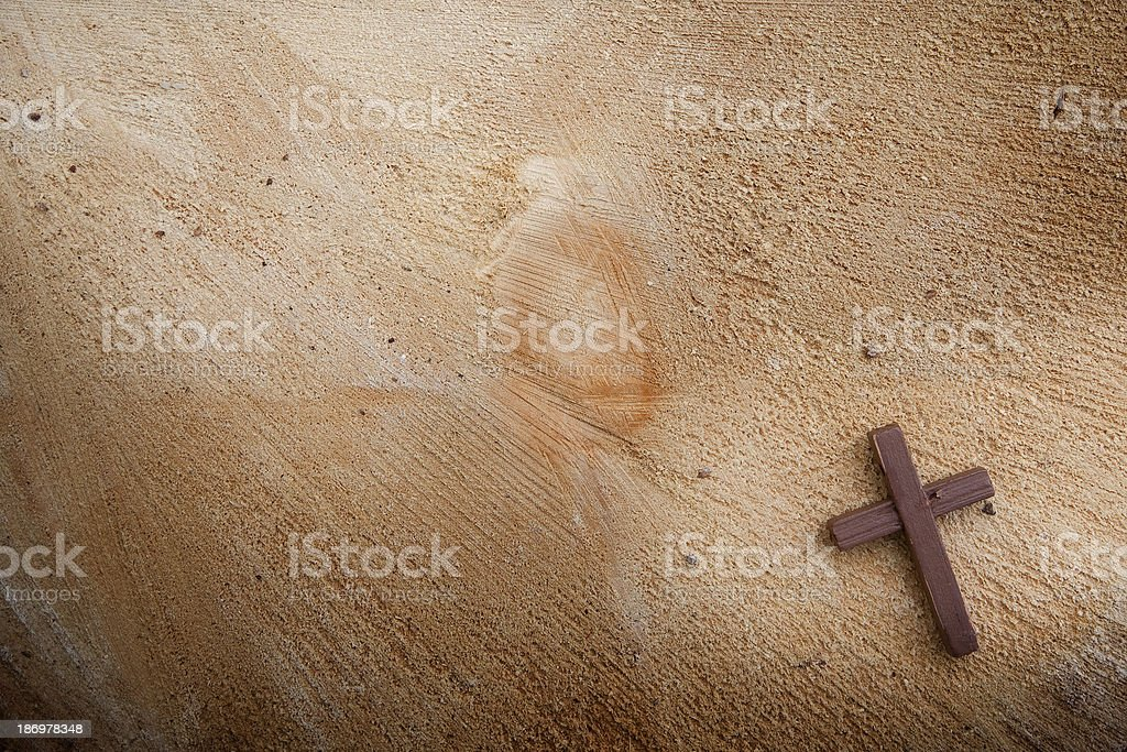 Wooden cross on a wooden background stock photo