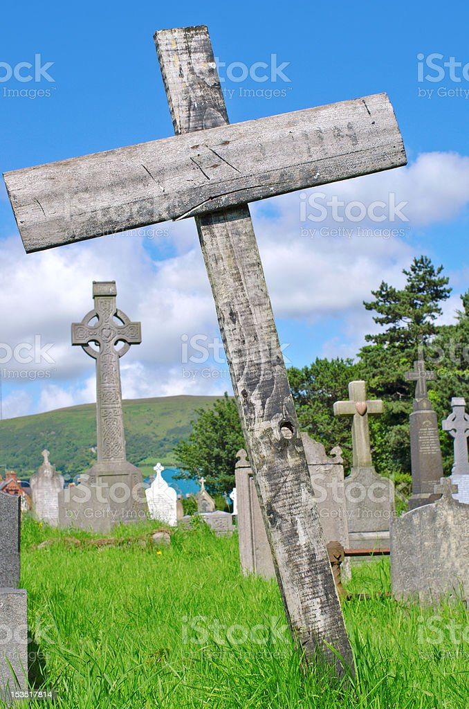 Wooden cross on pauper's grave royalty-free stock photo