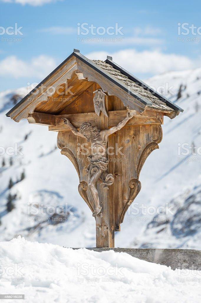 Wooden cross with Jesus Christ stock photo