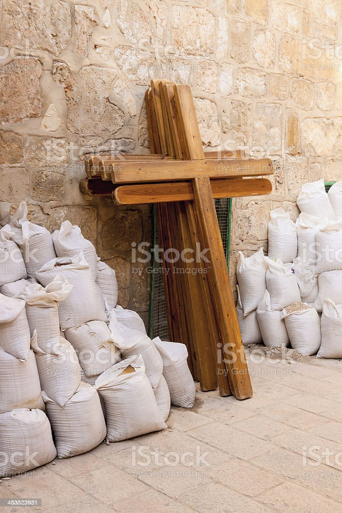 Wooden crosses and bugs leaning the wall royalty-free stock photo