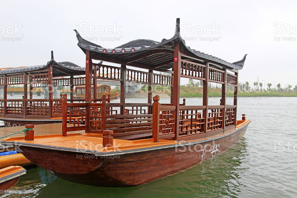 wooden cruise ship in a park royalty-free stock photo
