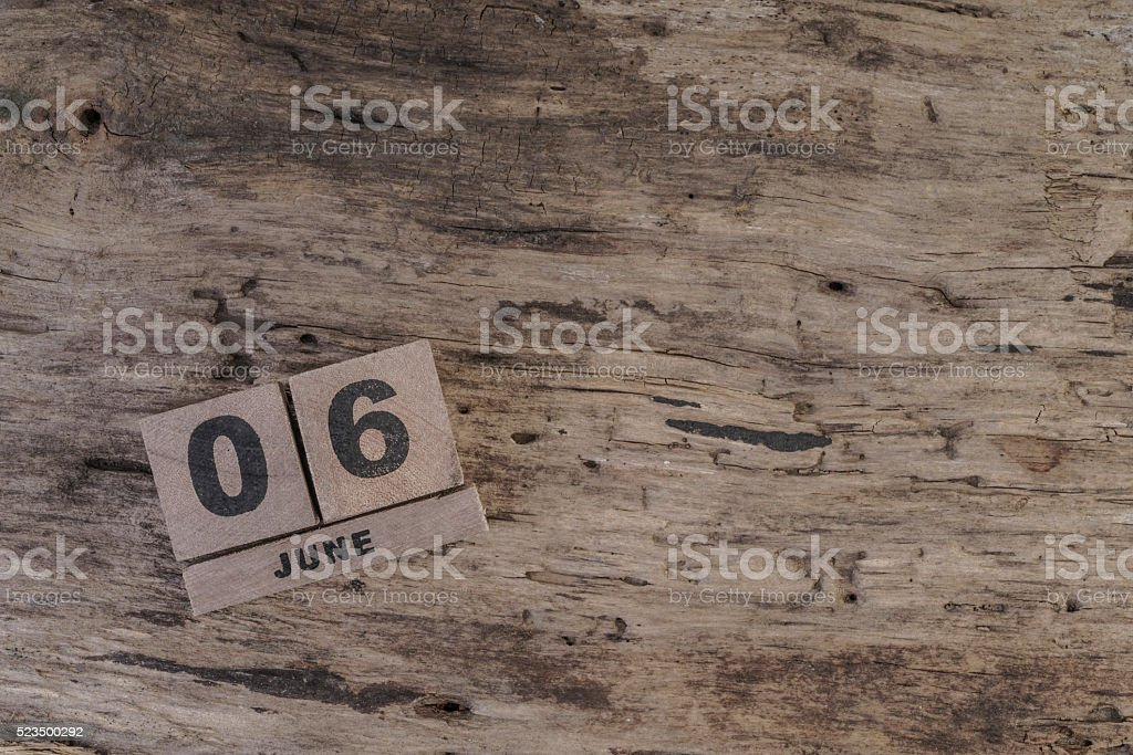 wooden cube calendar for june with copy space stock photo