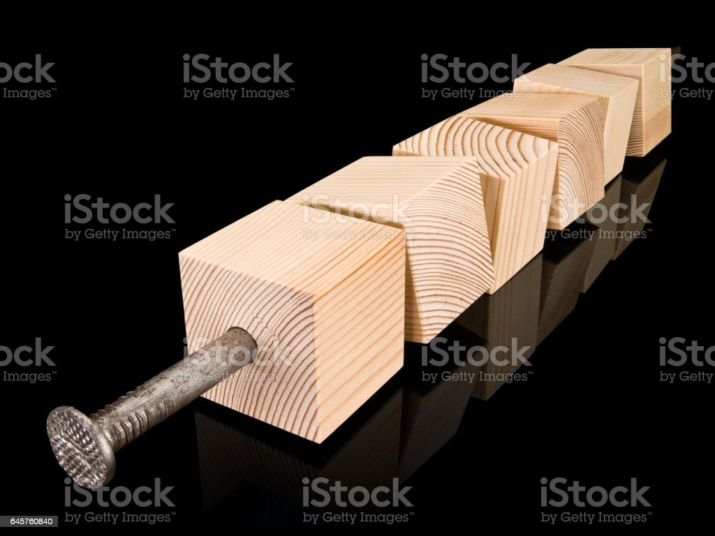 Wooden cubes strung on a steel nail stock photo