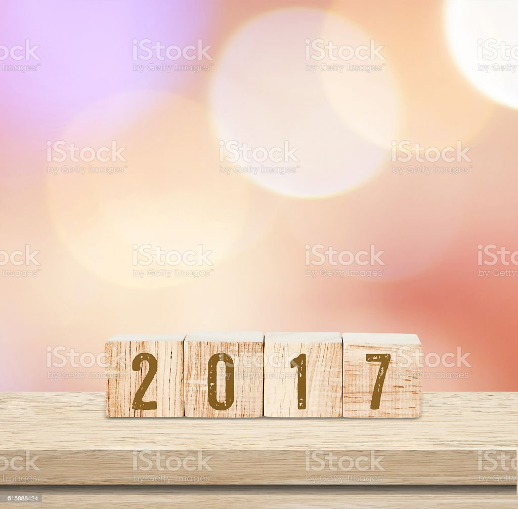 Wooden cubes with 2017  over blur bokeh background stock photo