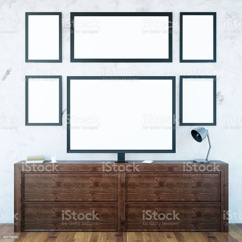 Wooden cupboard with monitor and frames stock photo