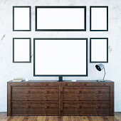 Wooden cupboard with monitor and frames
