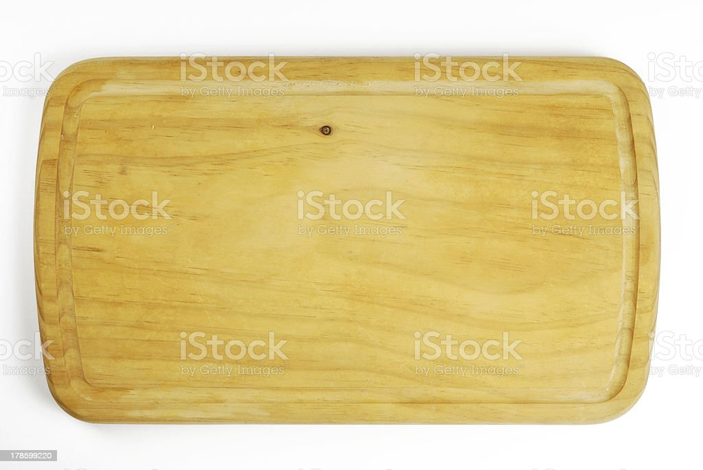 Wooden cutting board for the kitchen stock photo