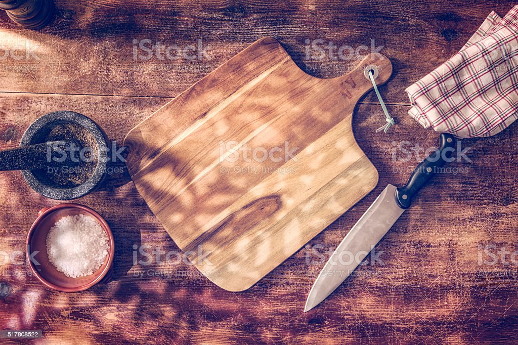 Wooden Cutting Board with Kitchen Knife stock photo