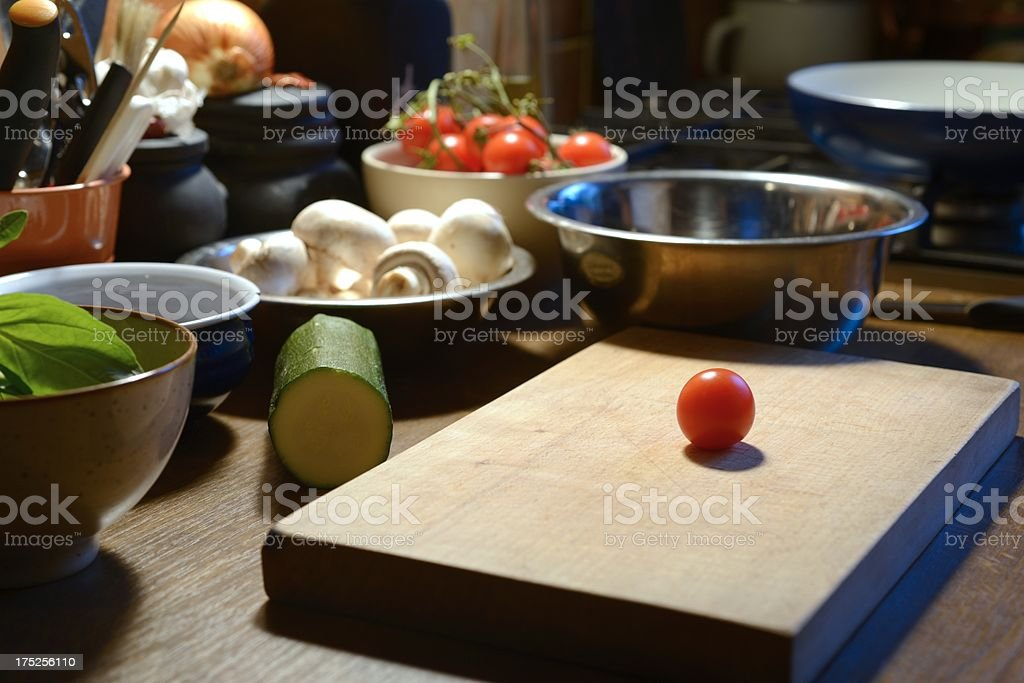 Wooden cutting board with vegetable royalty-free stock photo