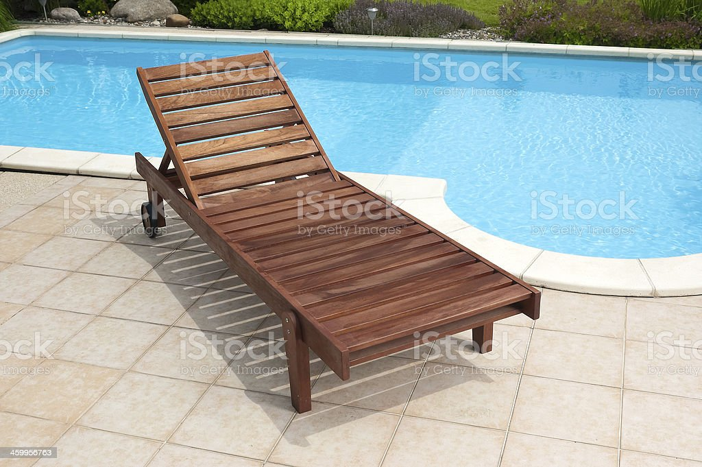 Wooden deckchair stock photo
