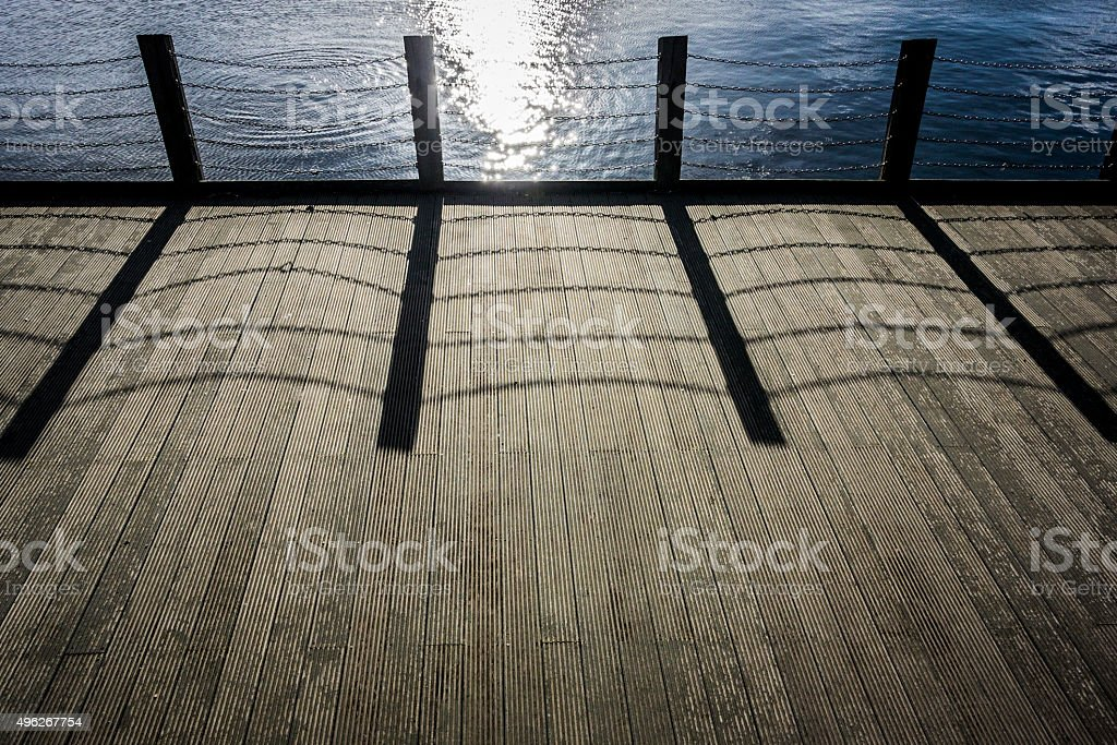 Wooden Decking with Chain Link Shadow stock photo