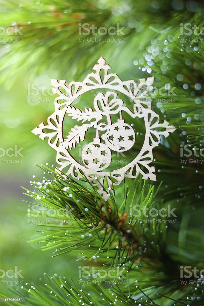 Wooden decoration on a christmas tree royalty-free stock photo