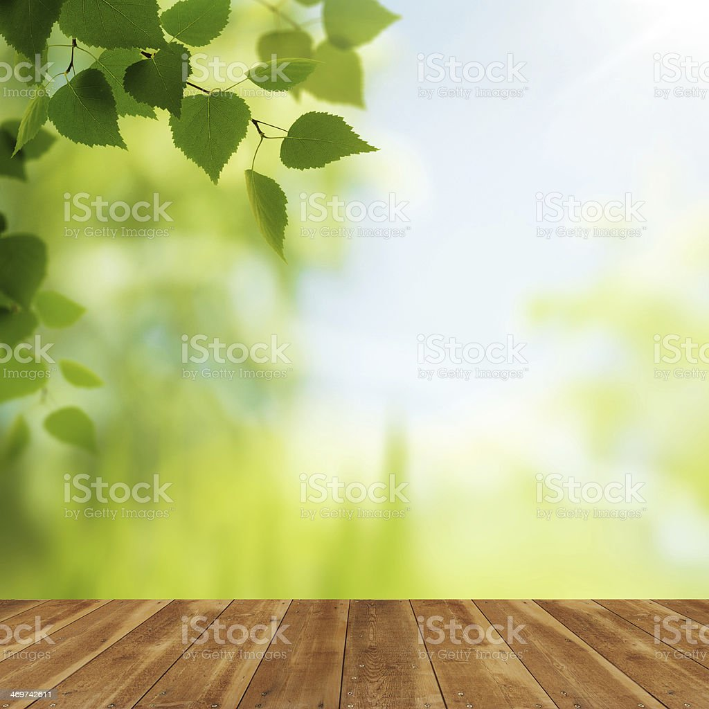 Wooden desk against beauty natural backgrounds for your design stock photo