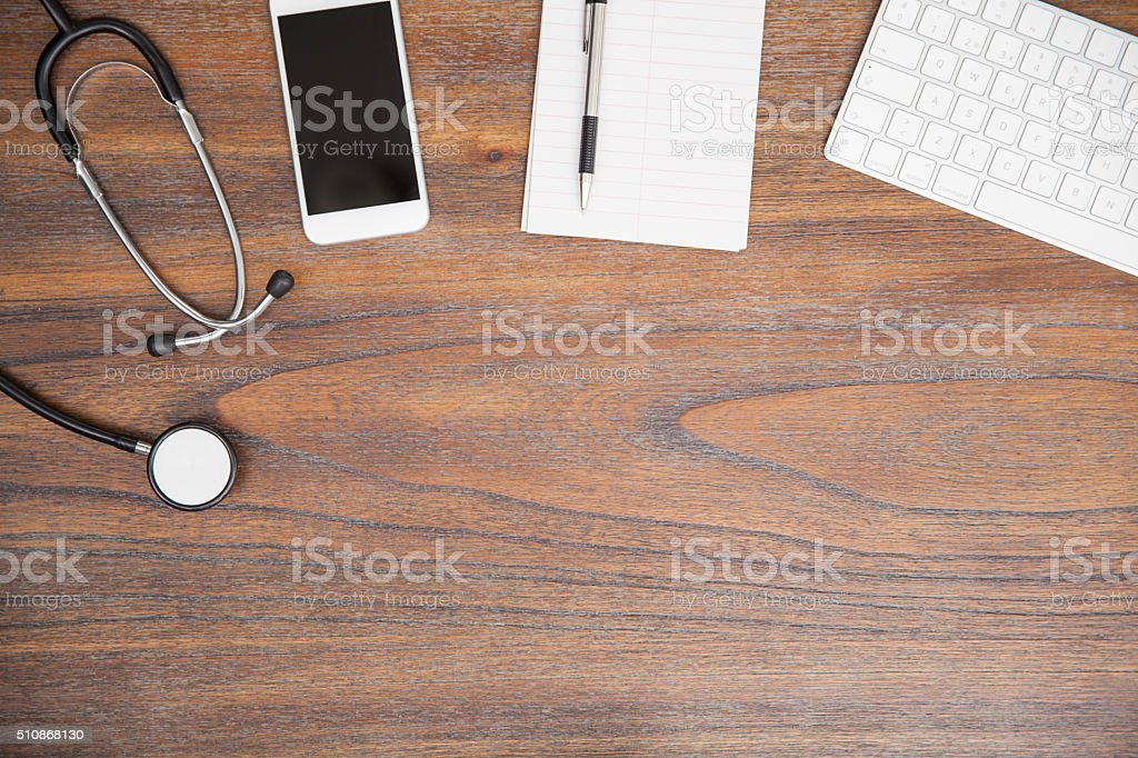 Wooden desk in doctor's office stock photo