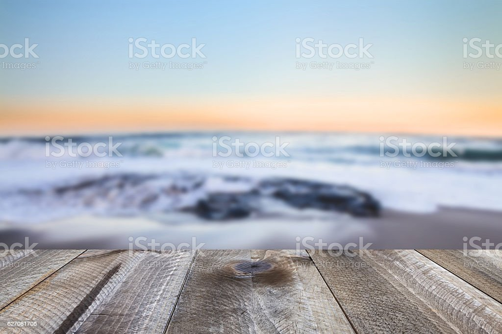 Wooden desk space and sea landscape stock photo