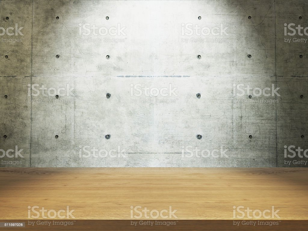 wooden desk with concrete wall stock photo