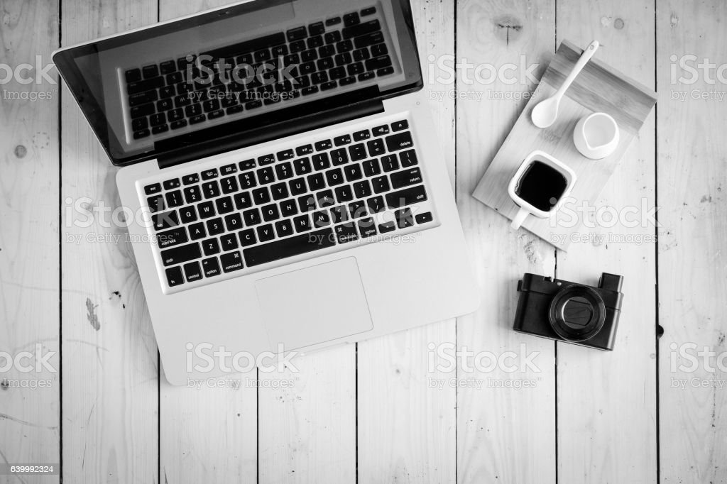 Wooden desk with various gadgets and accessories stock photo
