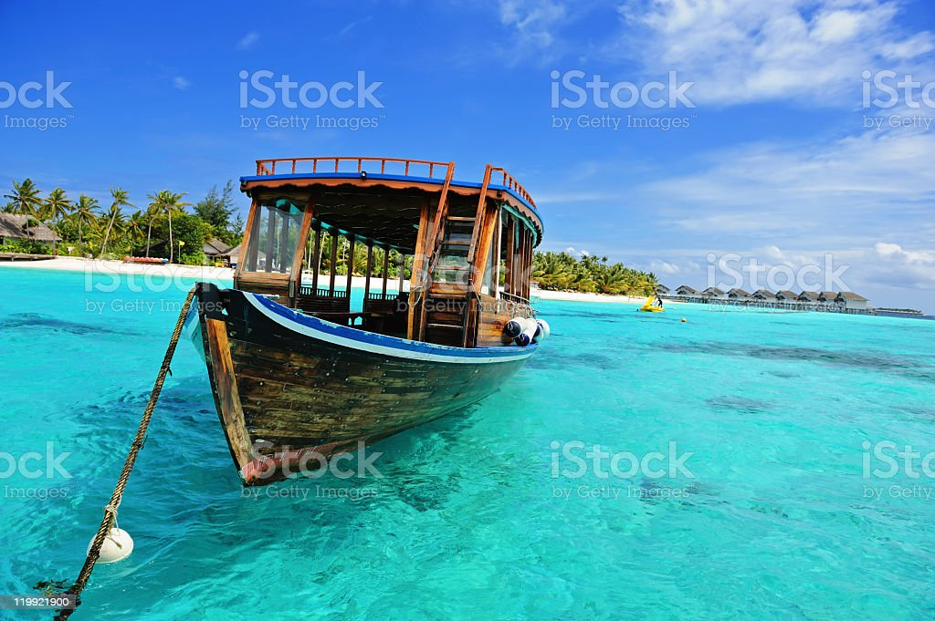 Wooden Dhoni boat on the clearwater ocean in Maldives  stock photo