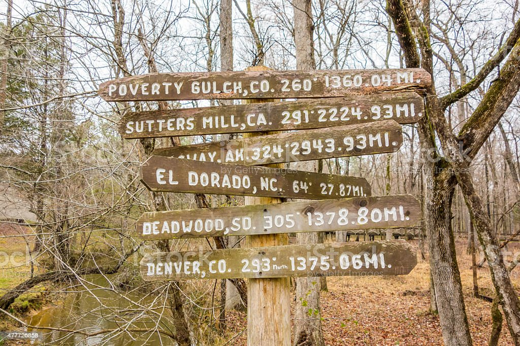 wooden direction sign in the forest stock photo