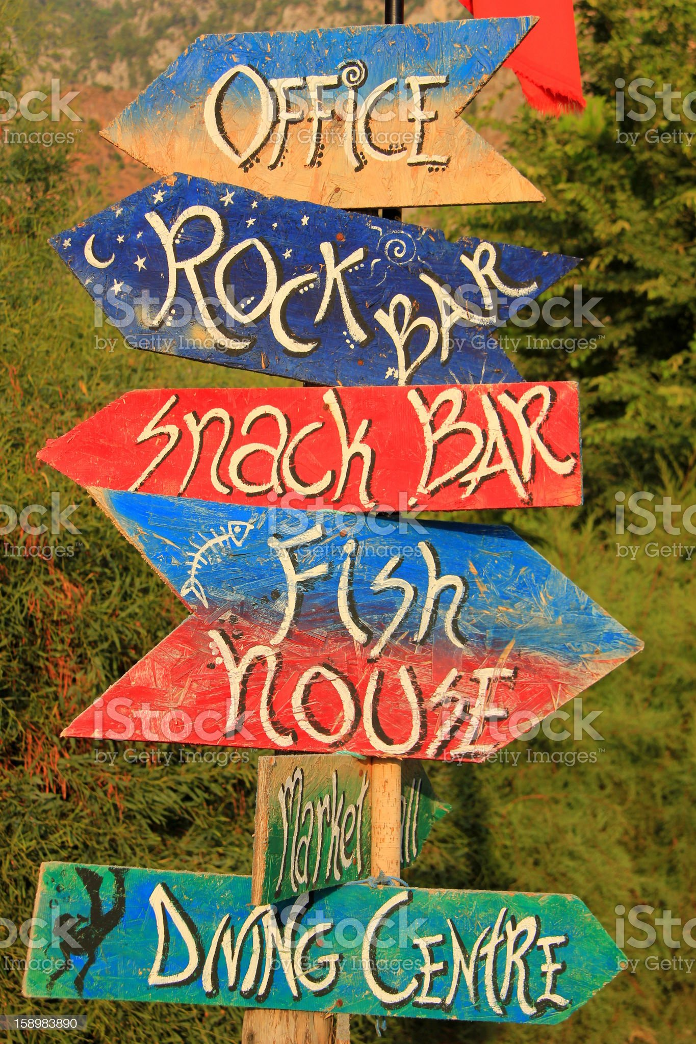 Wooden direction sign post pointing in different directions royalty-free stock photo