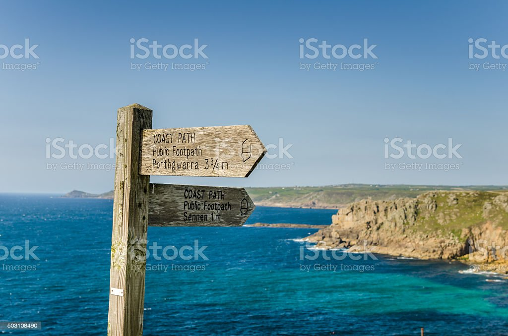 Wooden Directional Sign on a Coast Path stock photo