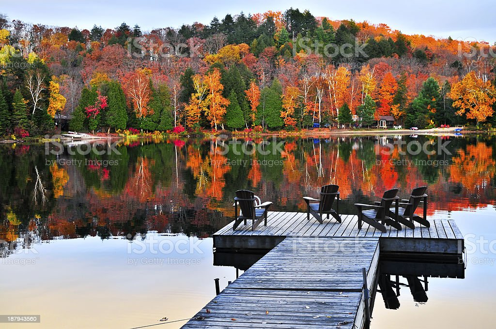 Wooden dock on autumn lake stock photo