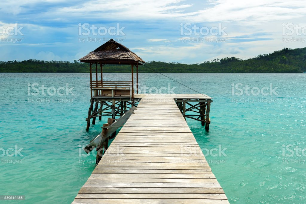 Wooden Dock on Togean Islands. Indonesia. stock photo