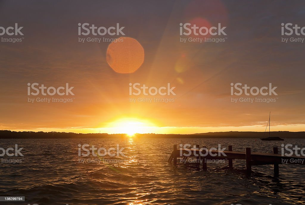 Wooden dock stretching into lake stock photo
