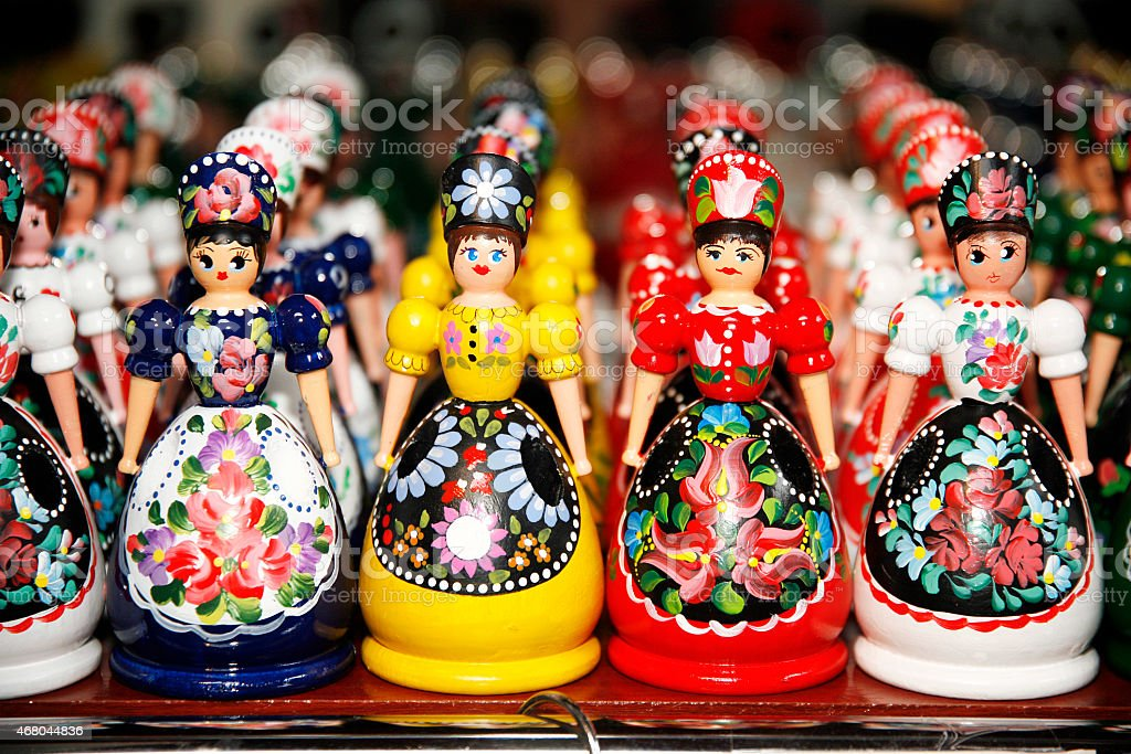 Wooden dolls in hungarian folk costumes as souvenir in row stock photo