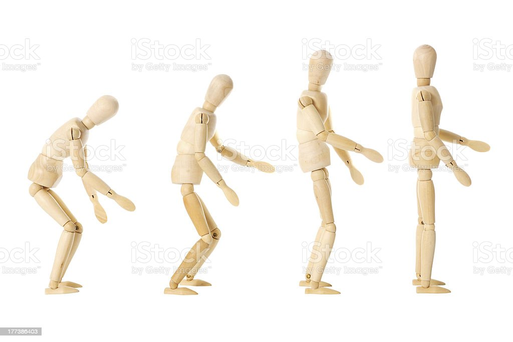 Wooden dolls with different postures stock photo