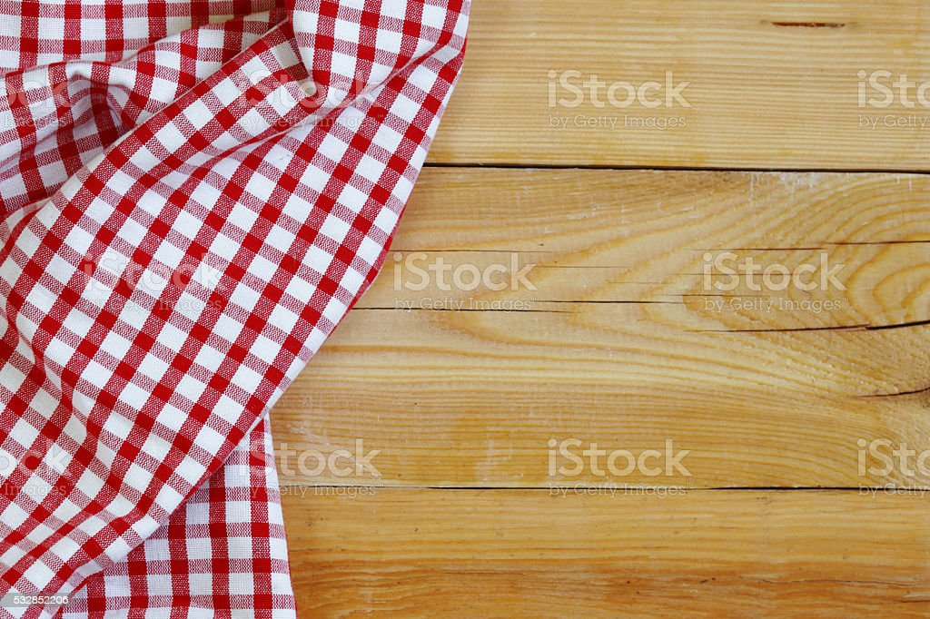 wooden domestic background with checkered kitchen towel, napkin stock photo