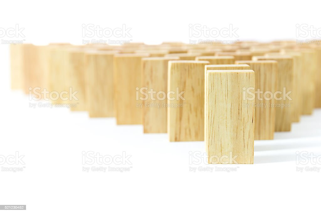 Wooden Domino in row stock photo
