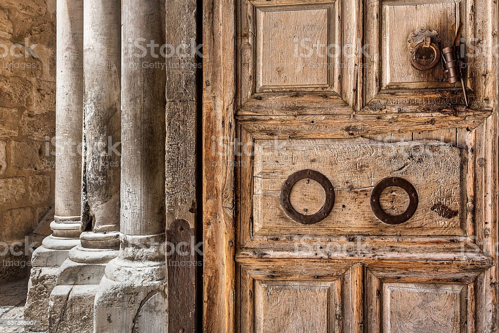 Wooden door at the entrance to Holy Sepulchre church. stock photo