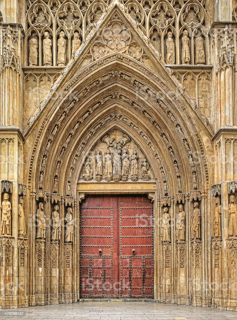 Wooden door at the entrance to Valencia Cathedral. stock photo