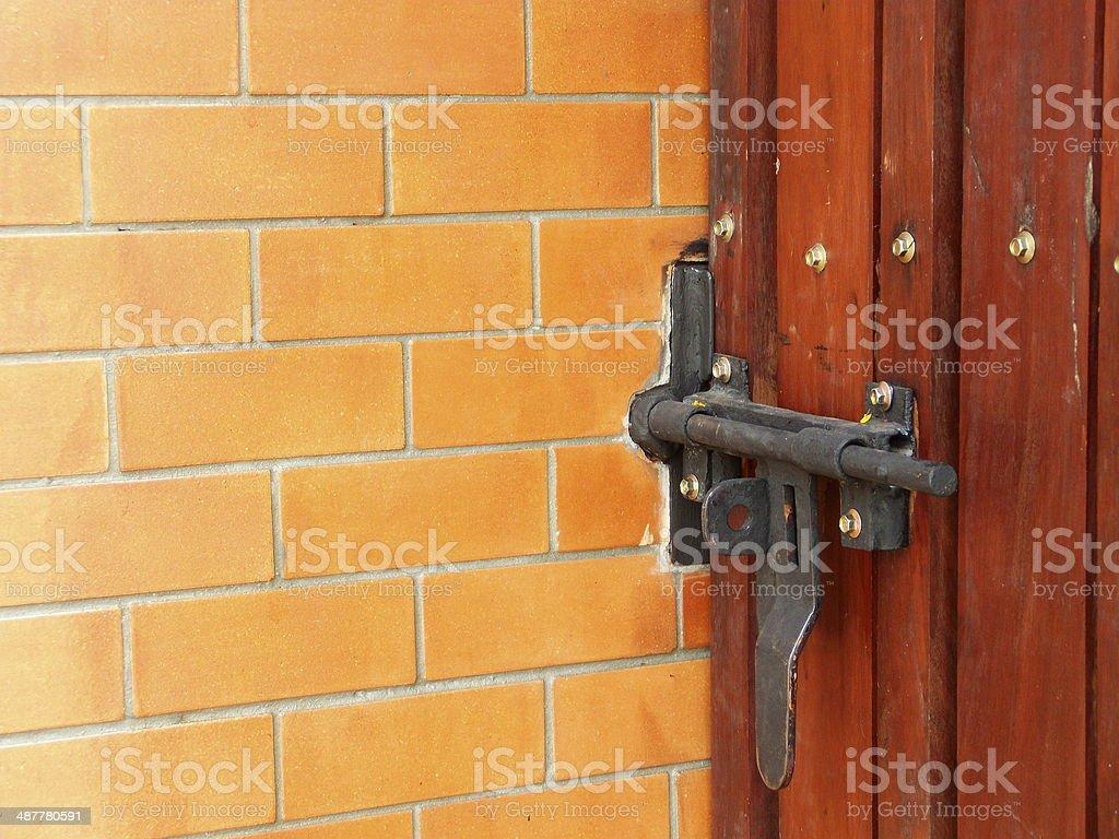 wooden door casement in a red brick wall stock photo