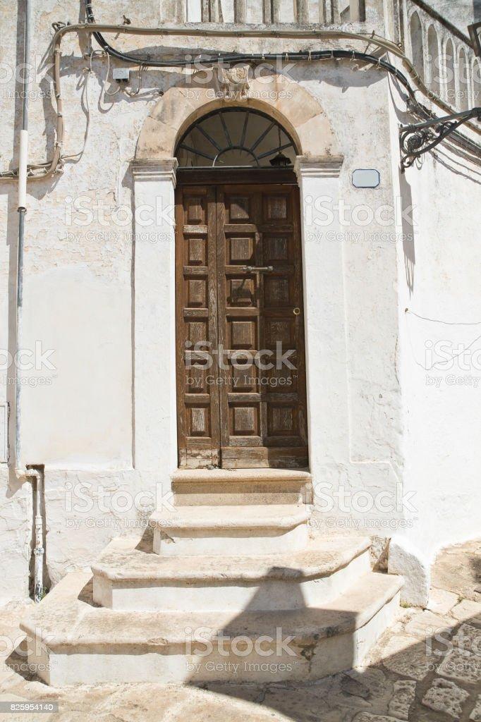 Wooden door. Ceglie Messapica. Puglia. Italy. stock photo