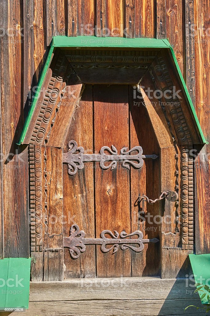 Wooden door decorated with carvings stock photo