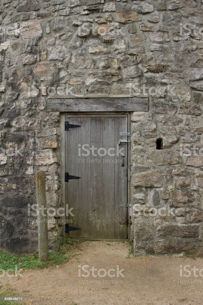 Wooden door entrance to old gristmill building stock photo