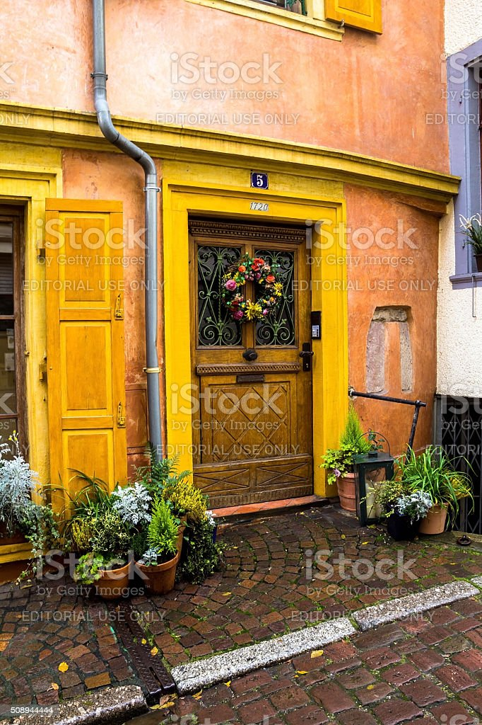 Wooden door entry to old house decorated for Christmas stock photo