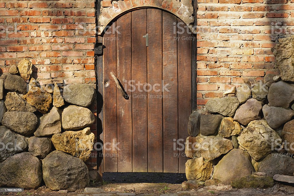 wooden door in a stone fence royalty-free stock photo
