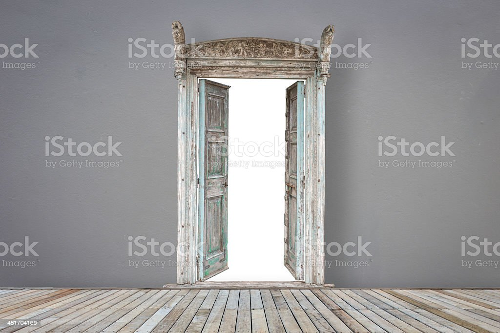 Wooden door in grey color room with wooden flooring stock photo
