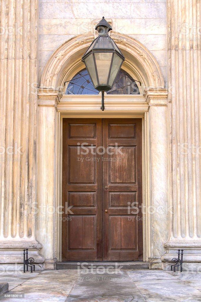 Wooden Door in Marble Entry stock photo