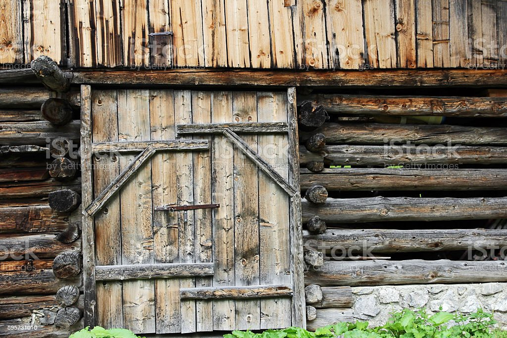 Wooden door of an old farmhouse stock photo