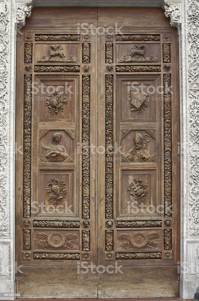 Wooden door of Basilica Santa Croce in Florence, Italy royalty-free stock photo