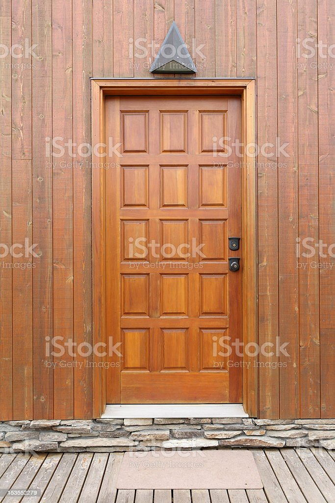 wooden door on a paneling wall stock photo