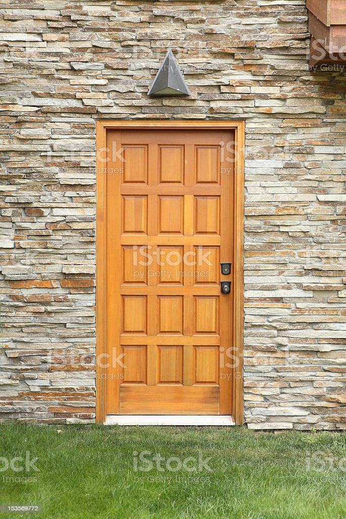 wooden door on a stone wall stock photo