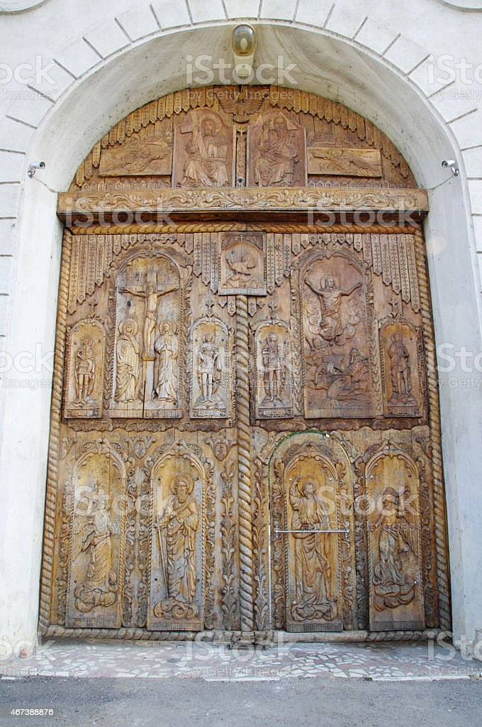 Wooden door on Cocos Monastery,  Dobrogea , Romania stock photo