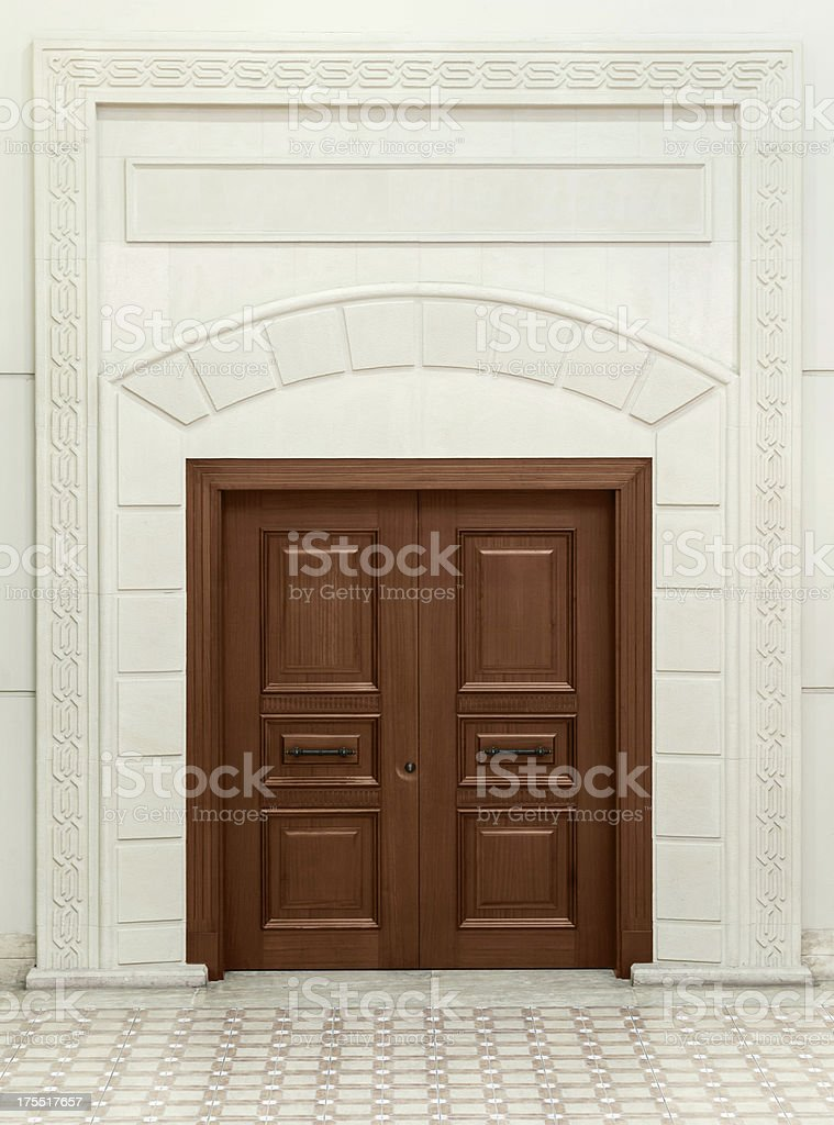 wooden door over ornate wall stock photo