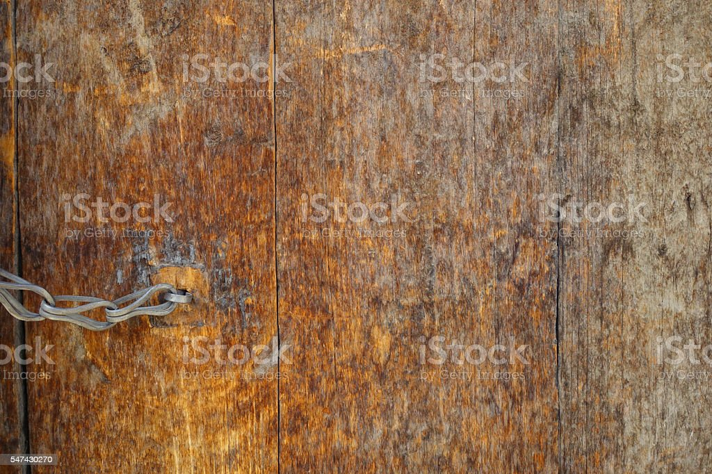 wooden door that's aging and battered with time stock photo
