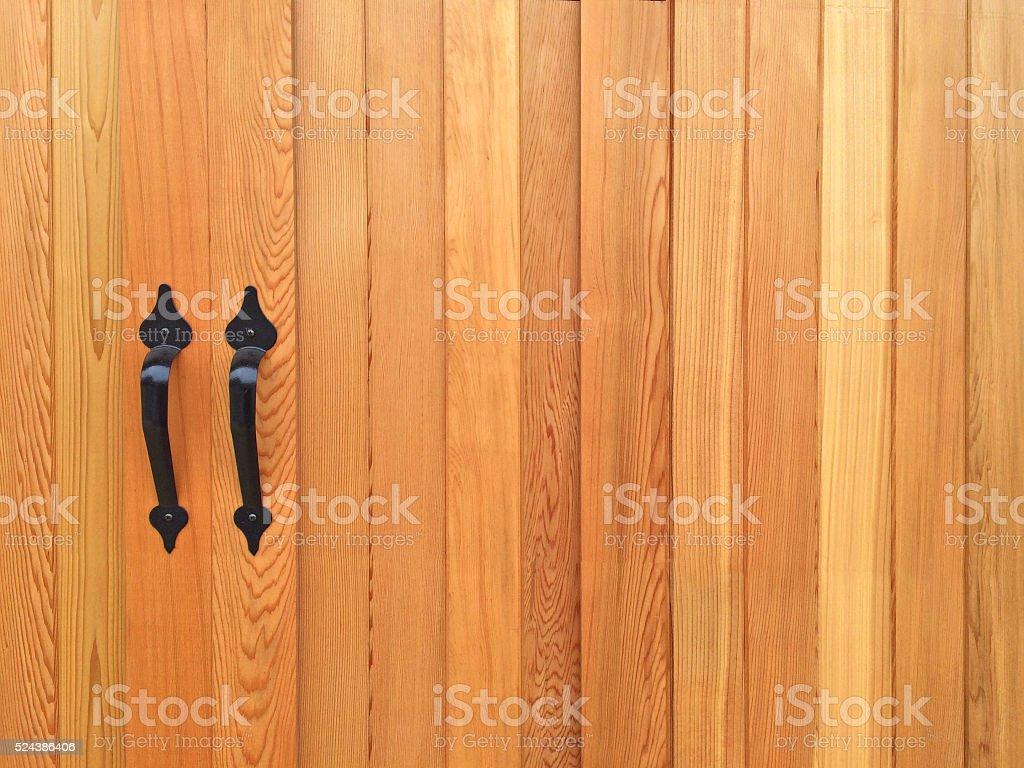 Wooden door with black door handles stock photo